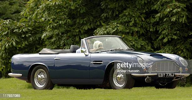 Prince Charles Prince of Wales and the Duchess of Cornwall arrive in the Prince's favourite DB Aston Martin car to compete in the Burberry Cup at...
