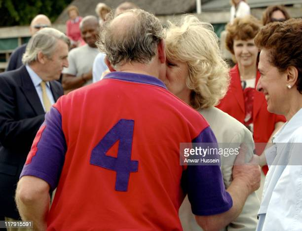 Prince Charles Prince of Wales and The Duchess of Cornwall kiss during the Burberry Cup at Cirencester Park Polo Club on June 17 2005 in...