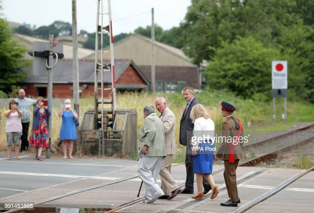 Prince Charles Prince of Wales arrives to mark the 150th anniversary of the Heart of Wales railway line while visiting Llandovery at Railway Station...