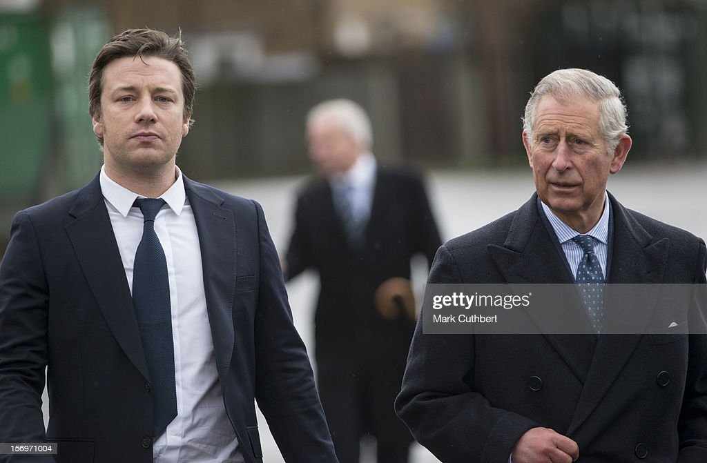 Prince Charles, Prince of Wales arrives with Jamie Oliver at Carshalton Boys Sports college to see how the school has transformed its approach to healthy eating on November 26, 2012 in Carshalton, England.