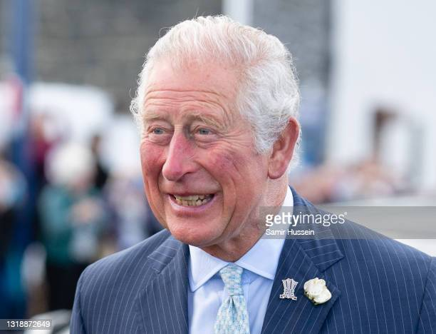 Prince Charles, Prince of Wales at Donaghadee Harbour where he viewed stones that line the walls and were decorated with messages of hope by local...