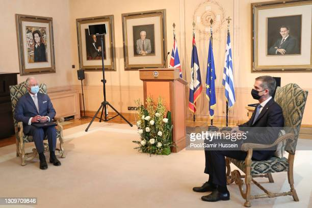 Prince Charles, Prince of Wales attends a meeting with Mayor of Athens, Kostas Bakoyannis in the City Council Chamber on March 25, 2021 in Athens,...