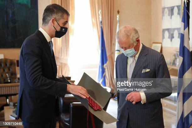 Prince Charles, Prince of Wales attends a meeting with the Mayor of Athens, Kostas Bakoyannis who presents His Royal Highness with a silk tie and a...