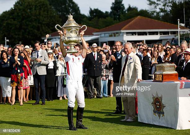 Prince Charles, Prince of Wales awards The Royal Salute Coronation Cup to James Beim of England after the victory in The Royal Salute Coronation Cup...