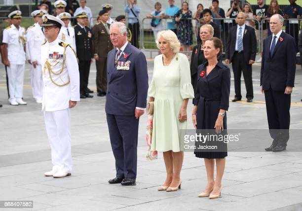 Prince Charles Prince of Wales Camilla Duchess of Cornwall and Alex Moore wife of the Defence Attache attend a memorial ceremony at the Cenotaph war...