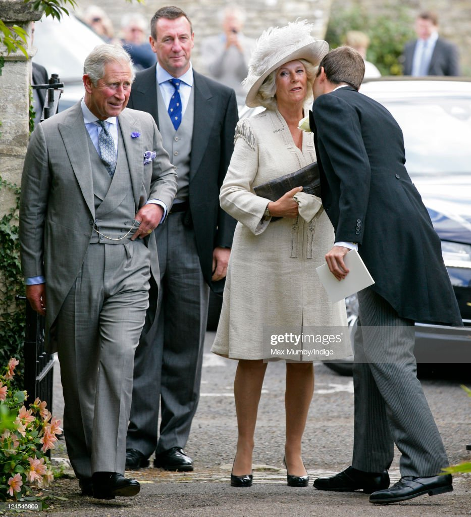 (L-R) Prince Charles, Prince of Wales, Camilla, Duchess of Cornwall and Ben Goldsmith attend the wedding of Ben Elliot and Mary-Clare Winwood at the church of St. Peter and St. Paul, Northleach on September 10, 2011 in Cheltenham, England.