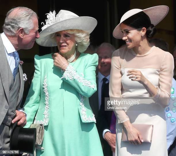 Prince Charles Prince of Wales Camilla Duchess of Cornwall and Meghan Duchess of Sussex share a laugh as they attend The Prince of Wales' 70th...