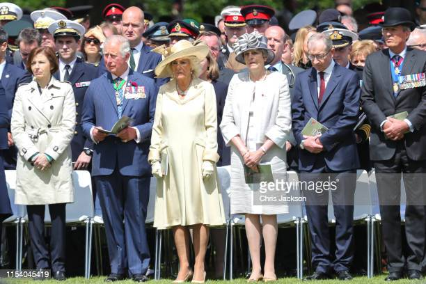Prince Charles Prince of Wales Camilla Duchess of Cornwall and Britain's Prime Minister Theresa May attend a memorial service at Bayeux War Cemetery...