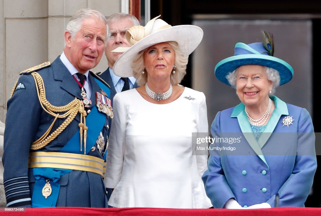 Prince Charles, Prince of Wales, Camilla, Duchess of Cornwall and Queen Elizabeth II watch a flypast to mark the centenary of the Royal Air Force from the balcony of Buckingham Palace on July 10, 2018 in London, England. The 100th birthday of the RAF, which was founded on on 1 April 1918, was marked with a centenary parade with the presentation of a new Queen's Colour and flypast of 100 aircraft over Buckingham Palace.