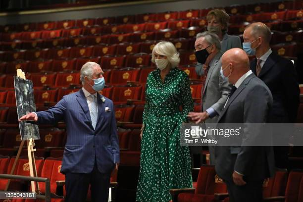 Prince Charles, Prince of Wales, Camilla, Duchess of Cornwall, Lady Madeleine Lloyd Webber and Lord Andrew Lloyd Webber during a visit to Theatre...