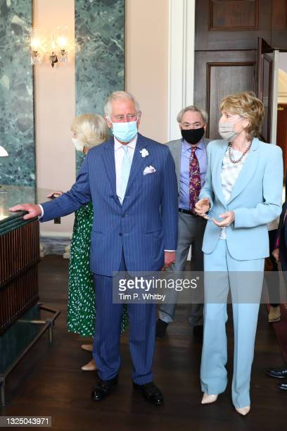 Prince Charles, Prince of Wales, Camilla, Duchess of Cornwall, Lord Andrew Lloyd Webber and Lady Madeleine Lloyd Webber during a visit to Theatre...