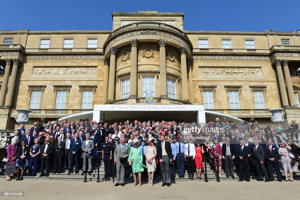 Prince Charles, Prince of Wales, Camilla, Duchess of Cornwall, Meghan, Duchess of Sussex and Prince Harry, Duke of Sussex pose with guests as they attend The Prince of Wales' 70th Birthday Patronage Celebration held at Buckingham Palace on May 22, 2018 in London, England.