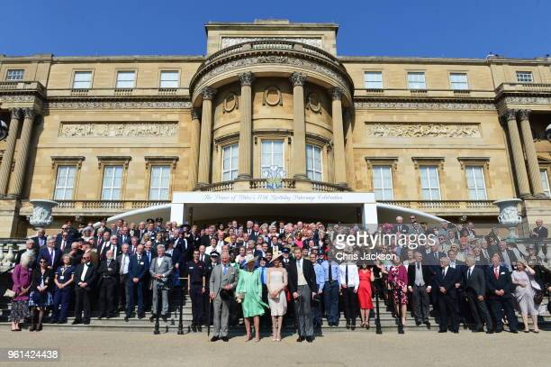 Prince Charles Prince of Wales Camilla Duchess of Cornwall Meghan Duchess of Sussex and Prince Harry Duke of Sussex pose with guests as they attend...