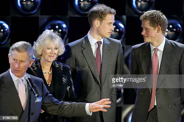 Prince Charles, Prince of Wales, Camilla, Duchess of Cornwall, Prince Harry and Prince William speak on stage as presenter Cat Deeley looks on during...