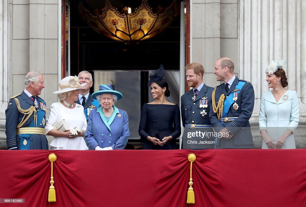 Prince Charles, Prince of Wales, Camilla, Duchess of Cornwall, Prince Andrew, Duke of York, Queen Elizabeth II, Meghan, Duchess of Sussex, Prince Harry, Duke of Sussex, Prince William, Duke of Cambridge and Catherine, Duchess of Cambridge watch the RAF flypast on the balcony of Buckingham Palace, as members of the Royal Family attend events to mark the centenary of the RAF on July 10, 2018 in London, England.