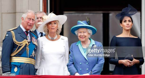 Prince Charles Prince of Wales Camilla Duchess of Cornwall Queen Elizabeth II and Meghan Duchess of Sussex watch a flypast to mark the centenary of...