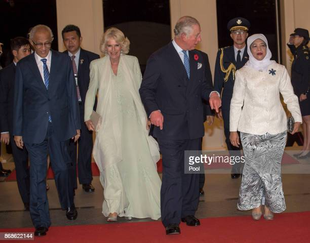 Prince Charles Prince of Wales Camilla Duchess of Cornwall Singapore President Halimah Yacob and her husband Mohamed Abdullah Alhabshee attend a...