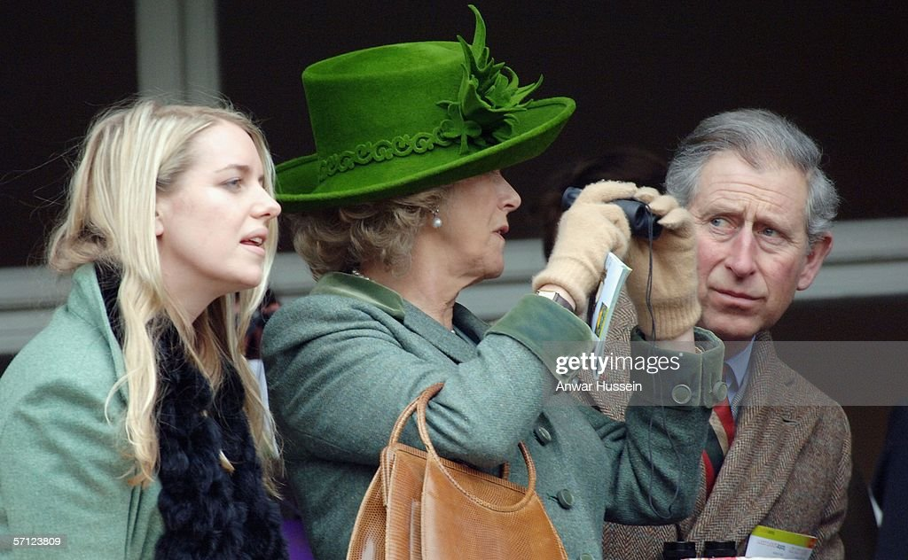 Prince Charles, Prince of Wales, Camilla, Duchess of Cornwall, wearing a St. Patrick's Day themed hat designed by Patrick Treacy, and Laura Parker-Bowles attend the Totesport Cheltenham Gold Cup, one of the biggest races of the National Hunt season taking place on the last day of the National Hunt Festival at Cheltenham Racecourse on March 17, 2006 in Cheltenham, England.