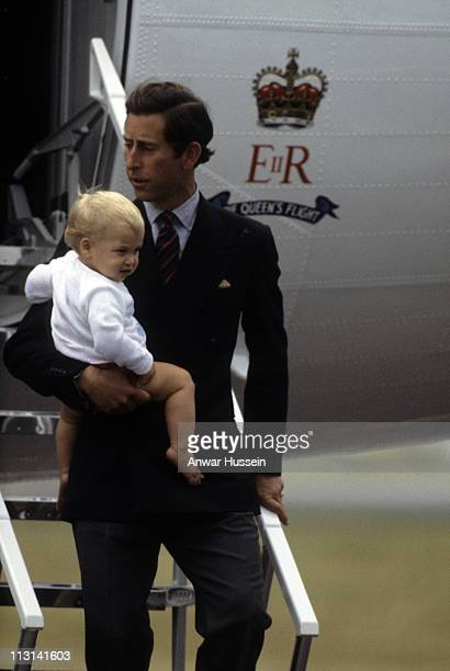 Prince Charles Prince of Wales carries Prince William as they arrive at Aberdeen Airport for a visit to Balmoral on October 24 1983 in Scotland