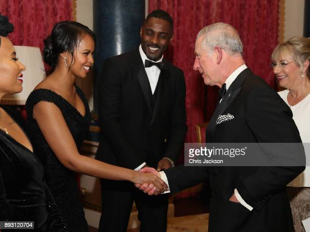 Prince Charles Prince of Wales chats to actor Idris Elba and his partner Sabrina Dhowre as he hosts the 'One Million Young Lives' dinner at...