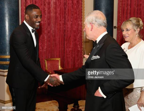 Prince Charles Prince of Wales chats to actor Idris Elba as he hosts the 'One Million Young Lives' dinner at Buckingham Palace on December 14 2017 in...