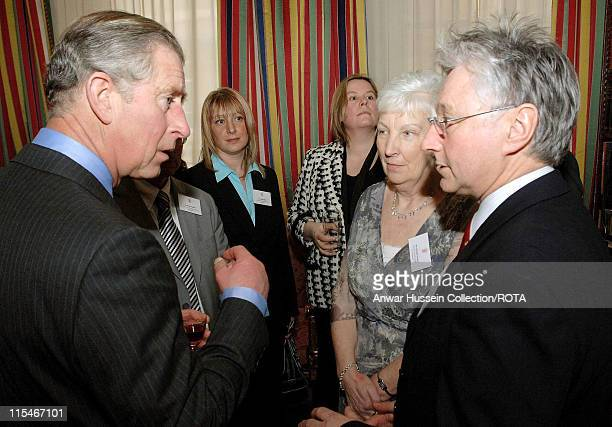 Prince Charles Prince of Wales chats to Dr Sam McGuinness and Mrs Christine Conway during a reception for school cooks at Clarence House on February...