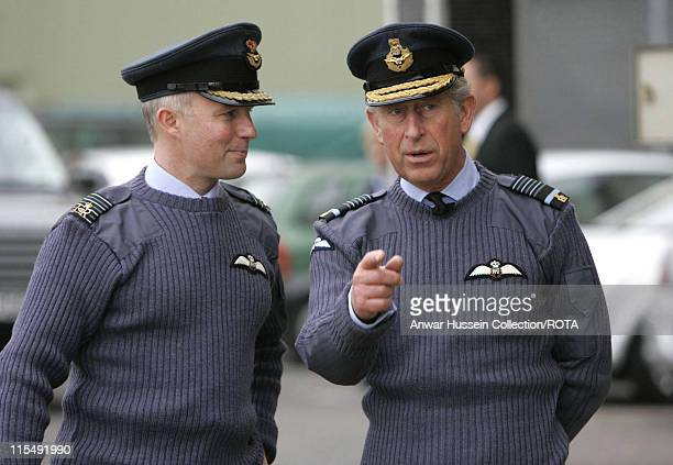 Prince Charles Prince of Wales chats to Group Captain Malcolm Brecht during a visit to RAF Brize Norton on October 26 2007 in Brize Norton England...