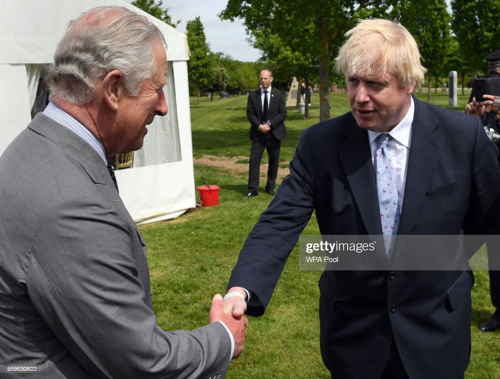 Prince Charles, Prince of Wales chats with Foreign Secretary, Boris Johnson following the dedication service for the National Memorial to British Victims of Overseas Terrorism at the National Memorial Arboretum on May 17, 2018 in Alrewas, England.