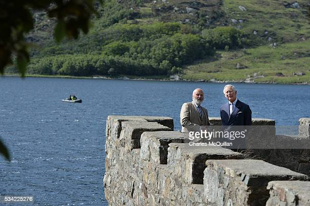 Prince Charles Prince of Wales chats with guide Mr Dave Duggan Divisional Manager Parks and Wildlife Service at Glenveagh Castle on May 25 2016 in...