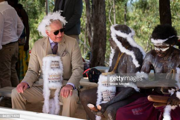 Prince Charles Prince of Wales chats with indigenous elders during a traditional Welcome to Country Ceremony on April 9 2018 in Gove Australia The...