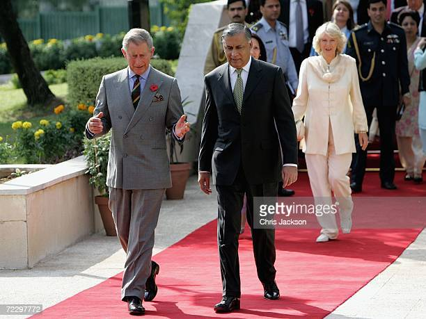 Prince Charles Prince of Wales chats with Prime Minister Shaukat Aziz whilst being followed by Camilla Duchess of Cornwall and Rukhsana Aziz before...