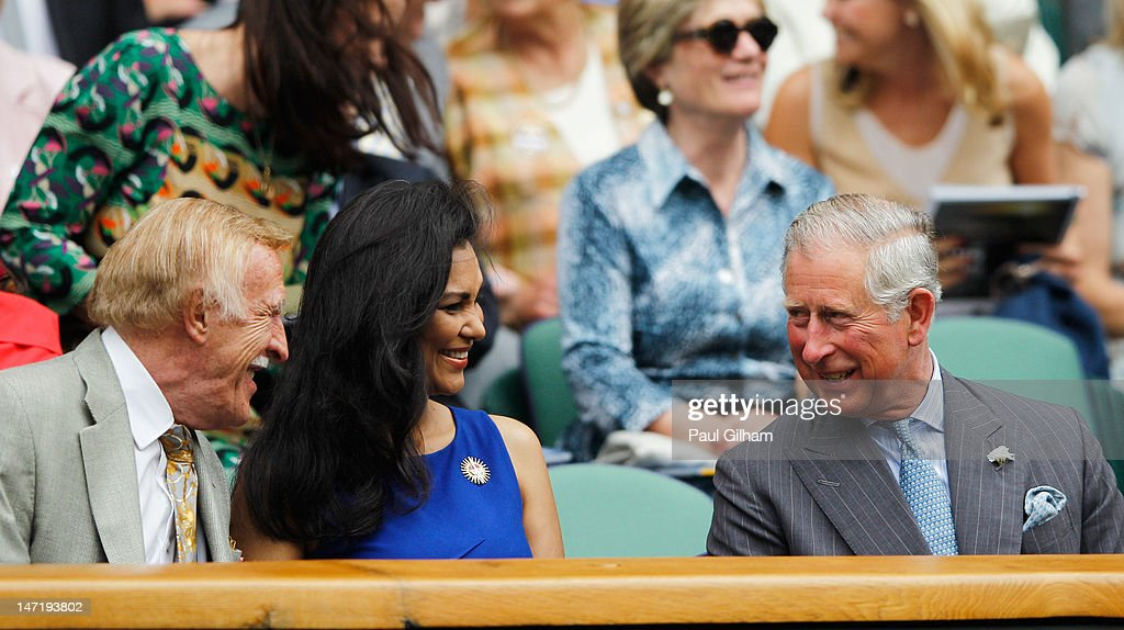 Prince Charles, Prince of Wales (R) chats with Sir Bruce Forsyth (L)and Lady Winnie Forsyth as Roger Federer of Switzerland plays Fabio Fognini of Italy in their Gentlemen's Singles second round match on day three of the Wimbledon Lawn Tennis Championships at the All England Lawn Tennis and Croquet Club on June 27, 2012 in London, England.