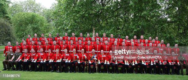 Prince Charles Prince of Wales Colonel poses with The Prince of Wales Company 1st Battalion Welsh Guards at Clarence House on May 22 2008 in London...