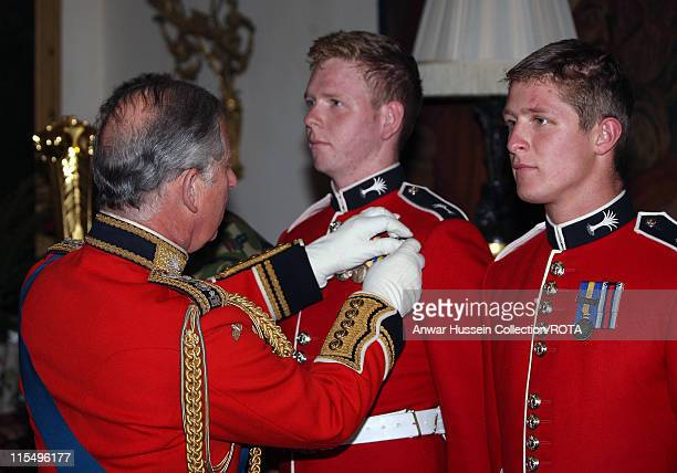 Prince Charles Prince of Wales Colonel presents operation medals to soldiers following a review of The Prince of Wales Company 1st Battalion Welsh...