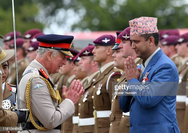 Prince Charles Prince of Wales ColonelinChief 1st Battalion The Royal Gurkha Rifles greets soldiers with the traditional namaste as he visits the...