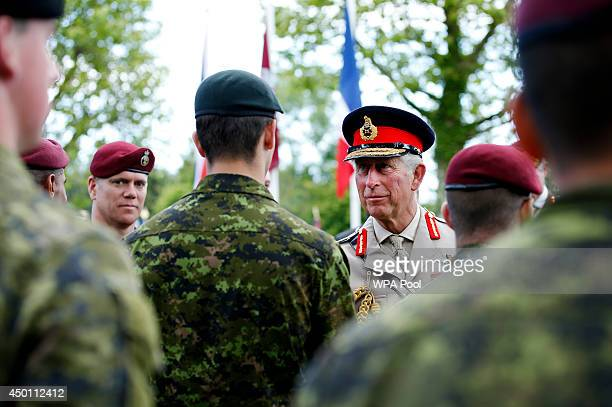 Prince Charles Prince of Wales ColonelinChief Army Air Corps greets current members of the Canadian Parachute Corps after a service of remembrance at...