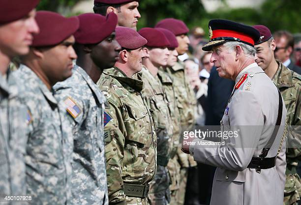 Prince Charles Prince of Wales ColonelinChief Army Air Corps meets with members of the British Parachute regiment as members of the US military look...