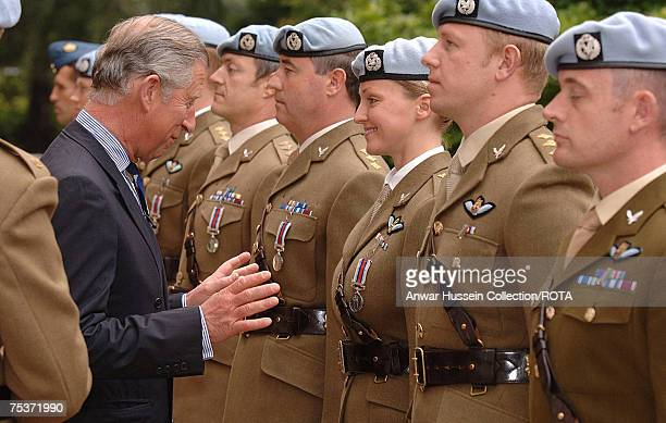 Prince Charles Prince of Wales ColonelinChief presents OP Herrick Medals to 9 Regiment Army Air Corps at Clarence House on July 11 2007 in London...