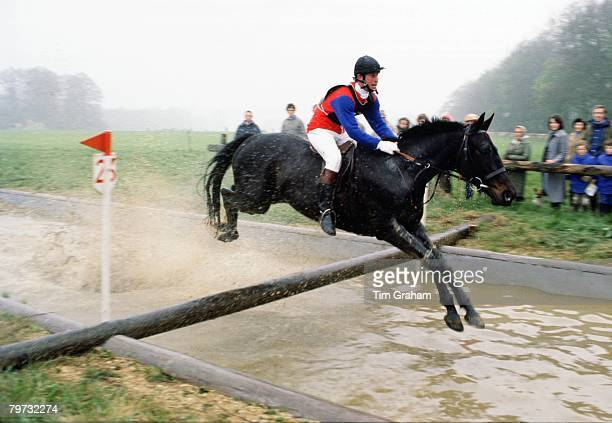 Prince Charles Prince of Wales competing in a cross country event in Cirencester He is riding a horse called Candlewick