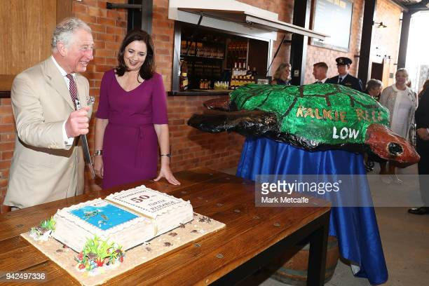 Prince Charles Prince of Wales cuts a cake after particpating in a tour of the Bundaberg Rum Distillery on April 6 2018 in Bundaberg Australia The...