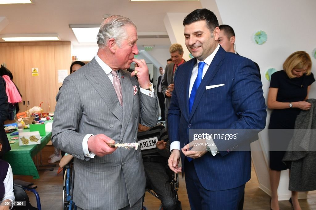 Prince Charles, Prince of Wales cuts the 25th anniversary cake while visiting Hospices of Hope on the third day of his nine day European tour on March 31, 2017 in Bucharest, Romania.