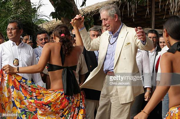 Prince Charles, Prince of Wales dances with 20 year old Nyara during a visit to Maguari Village in the Amazon Rainforest at Santaram on March 14,...
