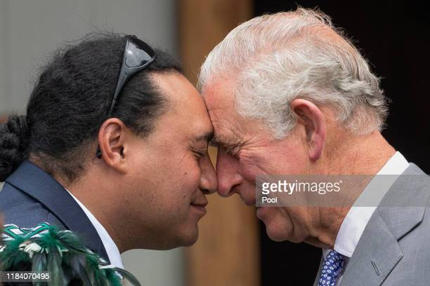 Prince Charles, Prince of Wales does a traditional Maori greeting, a hongi, during a visit to Takahanga Marae on November 23, 2019 in Kaikoura, New...