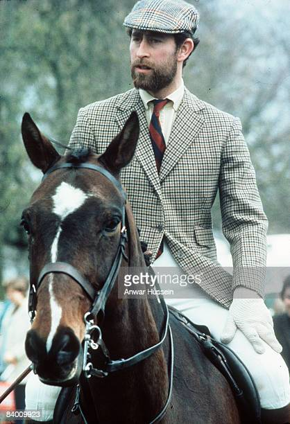 Prince Charles, Prince of Wales, dressed in traditional tweeds and sporting a smart naval beard, rides the acres of Badminton on May 3, 1976 in...
