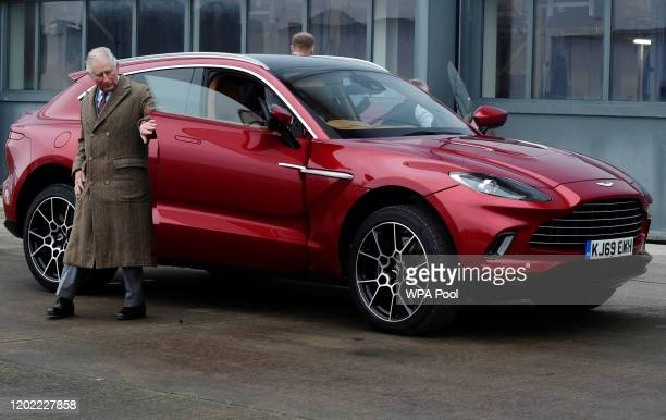 Prince Charles, Prince of Wales drives Aston Martin's first SUV the Aston Martin DBX during his visit to the new Aston Martin Lagonda factory on...