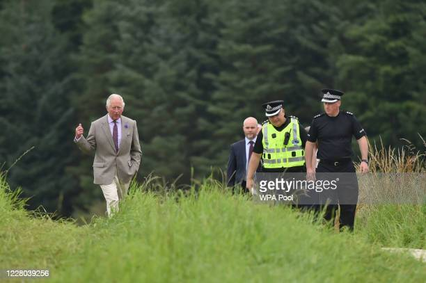 Prince Charles Prince of Wales during a visit to the scene at Stonehaven to meet first responders who attended the ScotRail train derailment near...