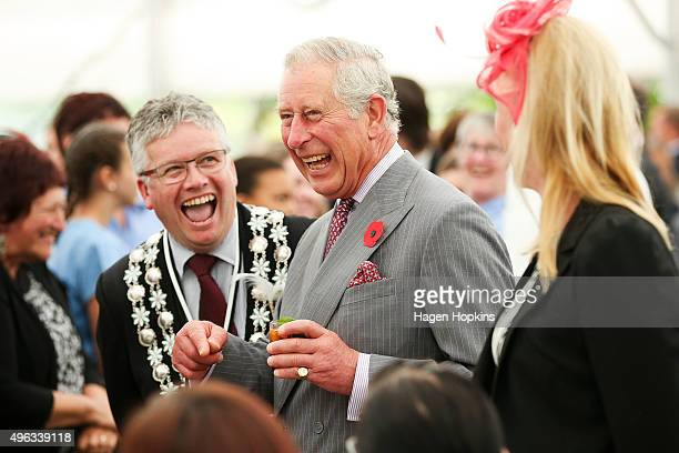 Prince Charles Prince of Wales enjoys a laugh with New Plymouth mayor Andrew Judd during the 'Tea With Taranaki' event at Brooklands Park on November...