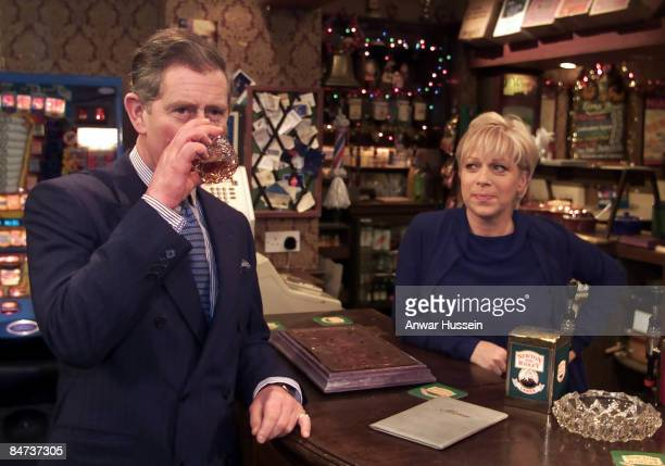 Prince Charles Prince of Wales enjoys a scotch with Coronation Street land lady Natalie Barnes played by Denise Welch in the Rovers Return on his...