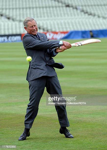 Prince Charles Prince of Wales faces England bowlers Ashley Giles and Sajid Mahmood during a visit to the Prince's Trust 12 week cricketing programme...