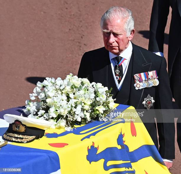 Prince Charles, Prince of Wales follows Prince Philip, Duke of Edinburgh's coffin as it is carried on a specially designed Land Rover Defender hearse...